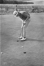 Golfer putting, Sweden, 1969. Artist: Unknown