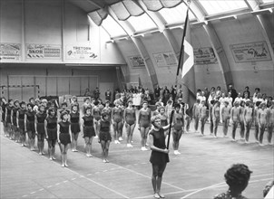 Female gymnasts parade in a gymnasium, Swedish National Day, Trelleborg, Sweden, 1969. Artist: Unknown