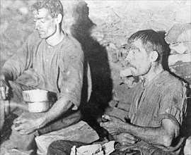 Miners enjoying a snack in the Brinsley Colliery pit, Nottinghamshire, 1913. Artist: Rev FW Cobb