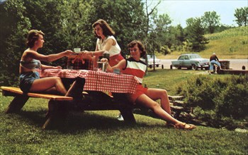 Three young women at a picnic table enjoying a meal, Snowdon, Montreal, Canada, 1955. Artist: Unknown