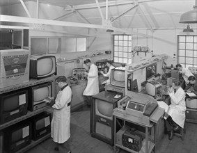 Technicians at work in Clays TV repair in shop, Mexborough, South Yorkshire, February 1959. Artist: Michael Walters