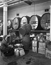 Whisky blending at Wiley & Co, Sheffield, South Yorkshire, 1960. Artist: Michael Walters