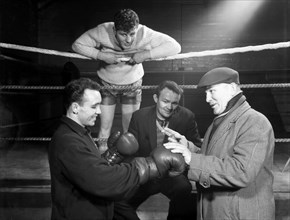A miner from Sunderland gets some ringside boxing advise, Newcastle, 1964.  Artist: Michael Walters