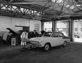 Scene in Globe & Simpson's auto electrical workshop, Nottingham, Nottinghamshire, 1961. Artist: Michael Walters