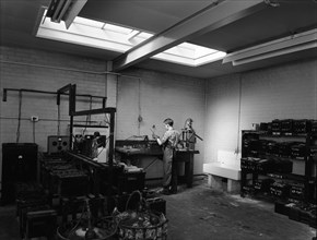 Scene in the workshops of Globe & Simpson auto electricians, Lincoln, Lincolnshire, 1961. Artist: Michael Walters