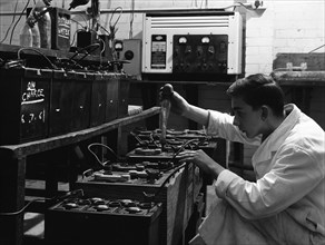 A young apprentice at Globe & Simpson auto electricians workshop, Lincoln, Lincolnshire, 1961. Artist: Michael Walters
