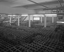 Warehouse full of crates of bottles, Ward & Sons, Swinton, South Yorkshire, 1960.  Artist: Michael Walters