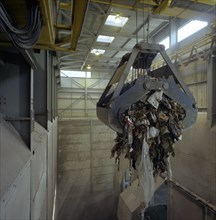 Waste ready for incineration in giant crane grab jaws, St Helier, Jersey, 1980.  Artist: Michael Walters