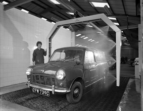Mini van being washed in a car wash, Co-op garage, Scunthorpe, Lincolnshire, 1965.  Artist: Michael Walters