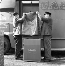 Home delivery of a cooker, Darfield, Barnsley, South Yorkshire, 1963. Artist: Michael Walters