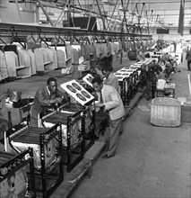 Immigrant workers on the cooker production line at the GEC, Swinton, South Yorkshire, 1962. Creator: Michael Walters.