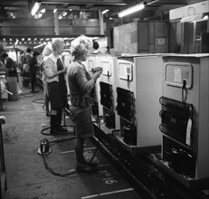 Fridge assembly line at the General Electric Company, Swinton, South Yorkshire, 1964.  Artist: Michael Walters