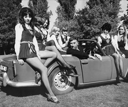 Frankie Howerd and some of the girls from St Trinian's at Shepperton Studios, Surrey, c1966. Artist: Unknown