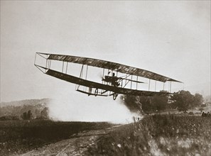 American aviator Glenn Curtiss making the first heavier-than-air flight in his 'June Bug', 1908. Artist: Edwin Levick