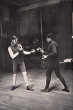 James J Corbett, American boxer, training with Jim Kennedy, 1900. Artist: Unknown