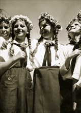 Four German girls smiling with garlands in their hair, c1936. Artist: Unknown