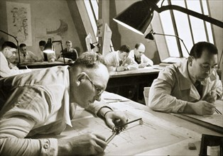 A drawing office scene, where new plans for fresh works are drawn up, Germany, 1936. Artist: Unknown
