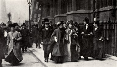 Emmeline Pankhurst, British suffragette leader, carrying a petition, London, 13 February 1908. Artist: Unknown