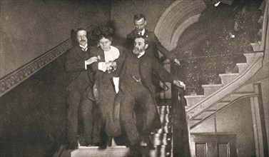Ejection of a woman questioner from City Temple, London, 12 November 1908. Artist: Unknown