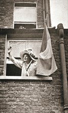 Christabel Pankhurst waving to the hunger strikers from a house overlooking Holloway Prison, 1909. Artist: Unknown