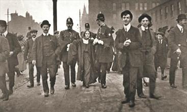 Arrest of Dora Marsden, British suffragette, outside the Victoria University of Manchester, 1909. Artist: Unknown
