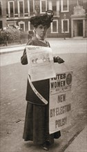 Miss Kelly, a suffragette, selling Votes for Women, July 1911. Artist: Unknown