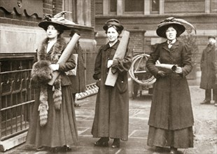 Suffragettes armed with materials to chain themselves to railings, 1909. Artist: Unknown