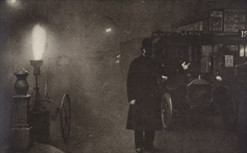 A constable directing traffic in the fog, London, c1910s-c1920s(?). Artist: Unknown