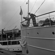 Ship by a quay, Stockholm harbour, Sweden, 1960. Artist: Torkel Lindeberg