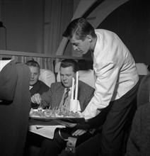 SAS steward serving snacks on a flight, 1960. Artist: Torkel Lindeberg