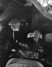 SAS stewardess serving on a flight, 1960. Artist: Torkel Lindeberg