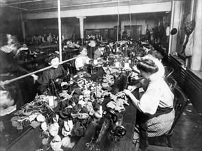 Women sewing teddy bears in a factory, c. 1915.