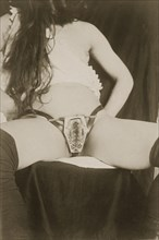Woman wearing a Chastity Belt, 1890's. Creator: French Photographer (19th century).
