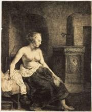'Half-Naked Woman by a Stove', 1658.  Artist: Rembrandt Harmensz van Rijn