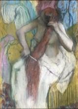 Woman Combing Her Hair. Artist: Degas, Edgar (1834-1917)