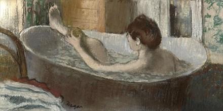 Woman in her Bath, Sponging her Leg, 1883-1884. Artist: Degas, Edgar (1834-1917)