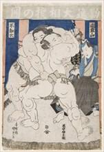 Sumo Wrestlers in Action, .