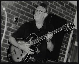 Jim Mullen playing guitar at The Fairway, Welwyn Garden City, Hertfordshire, 3 August 1997. Artist: Denis Williams