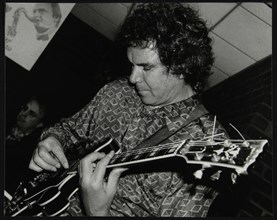 Guitarist John Etheridge playing at The Fairway, Welwyn Garden City, Hertfordshire, 9 November 2003. Artist: Denis Williams