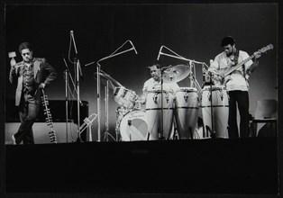 Dizzy Gillespie and guitarist Rodney Jones on stage, Beaulieu, Hampshire, July 1977. Artist: Denis Williams