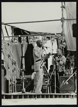Denis Williams photographing Eddie 'Cleanhead' Vinson at Knebworth, Hertfordshire, 1981. Artist: Unknown