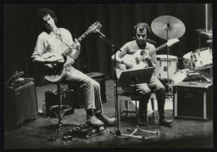John Etheridge and Gary Boyle playing at Campus West Welwyn Garden City, Hertfordshire, 1984. Artist: Denis Williams
