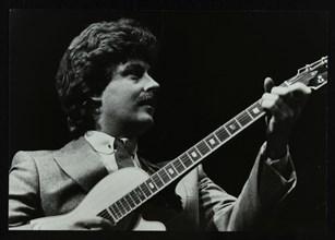 Guitarist Martin Taylor playing at the Forum Theatre, Hatfield, Hertfordshire, 1983. Artist: Denis Williams