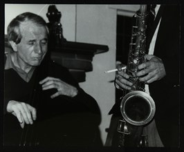 Phil Bates and the tenor saxophone of Spike Robinson at The Bell, Codicote, Hertfordshire, 1986. Artist: Denis Williams