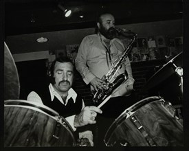 Alan Jackson (drums) and Don Weller (saxophone) playing at The Bell, Codicote, Hertfordshire, 1980. Artist: Denis Williams