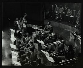 The Count Basie Orchestra in concert at Colston Hall, Bristol, 1957. Artist: Denis Williams