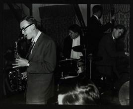 The John Cox Trio and Derek Humble playing at the Civic Restaurant, Bristol, 1955.  Artist: Denis Williams