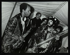 American saxophonist Ornette Coleman meets a clown, Bracknell Jazz Festival, Berkshire, 1978. Artist: Denis Williams