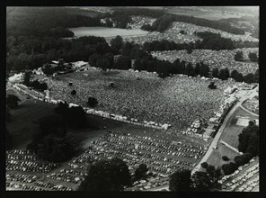 Aerial view of crowds at the Knebworth pop festival, 1986. Artist: Denis Williams