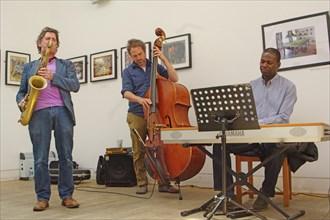 Basil Hodge, Ed Jones and Riaan Vosloo, Clock Tower Cafe, Croydon, London, 2015. Artist: Brian O'Connor.